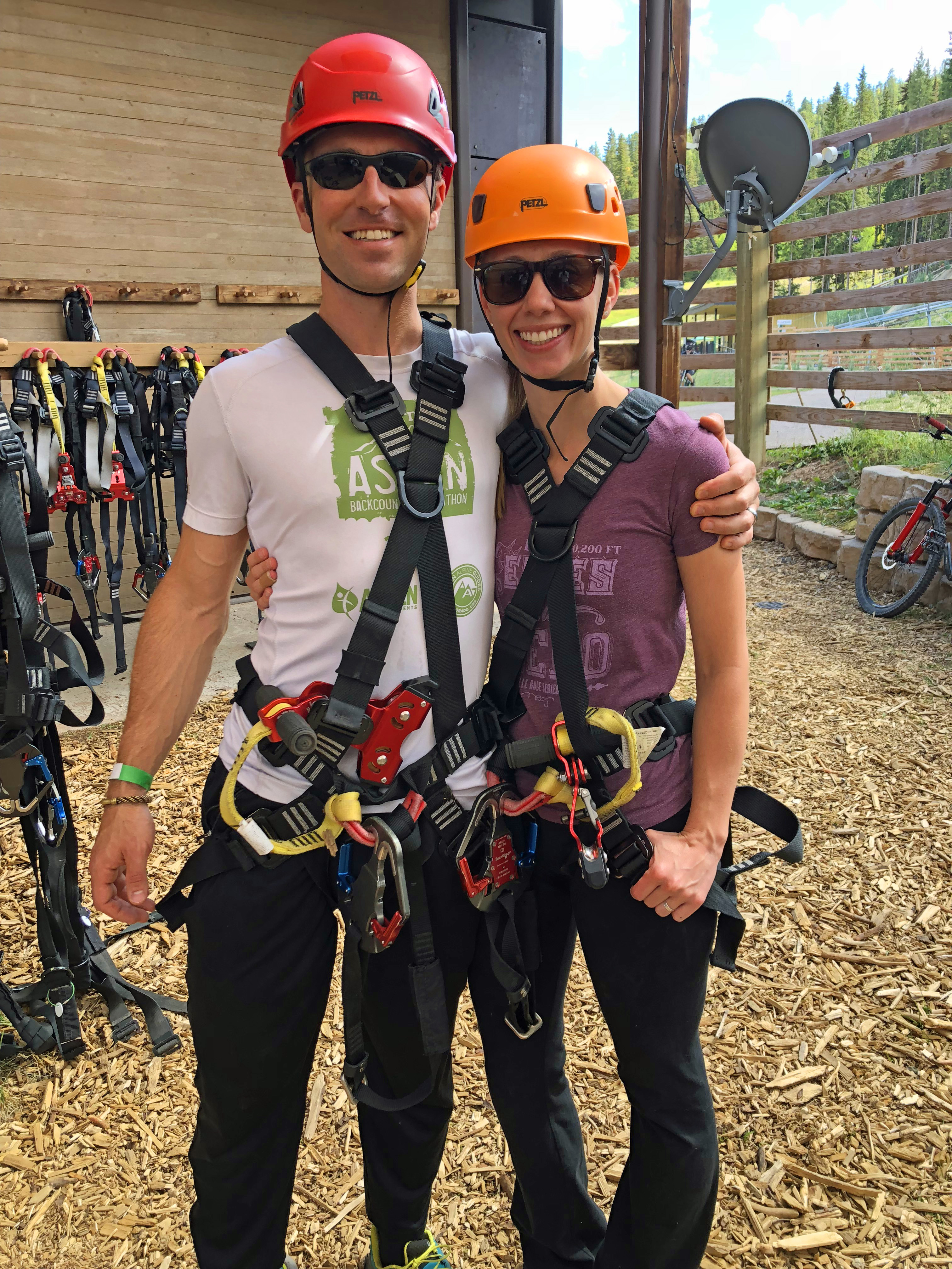 Couple in Climbing Harnesses Zip Lining in Colorado