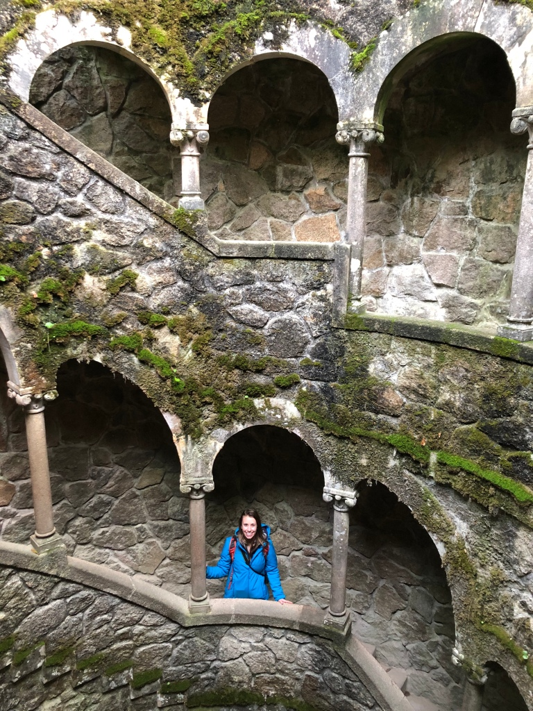 Woman Standing in Initiation Well in Quinta da Regaleira Sintra Portugal