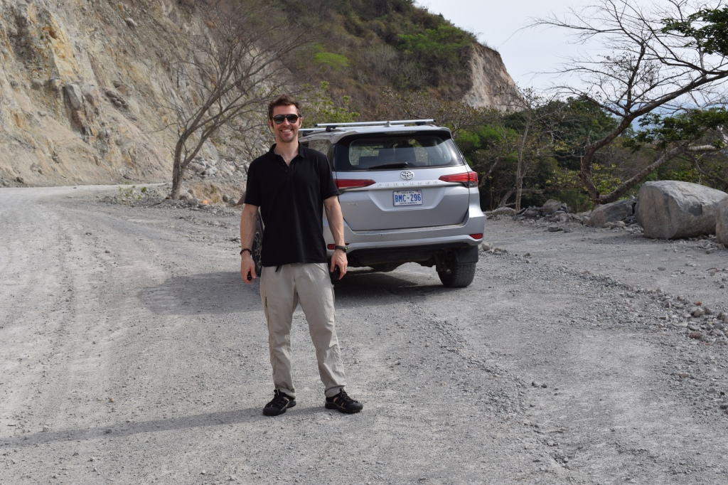 Man standing in front of Toyota Fortuna in Costa Rica