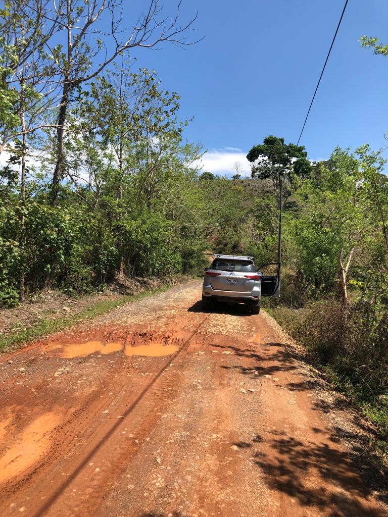 Toyota Fortuna on muddy road in Manuel Antonio, Costa Rica